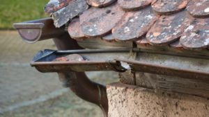 rusted gutters on a home