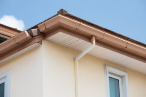brand new gutters on a house that has just been painted