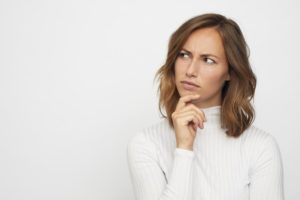 woman asking questions to choose the right company for gutter replacement